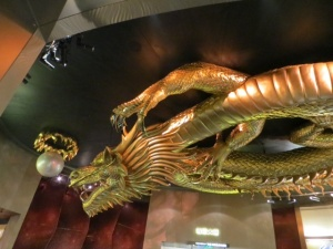 Golden dragon reaching for the pearl